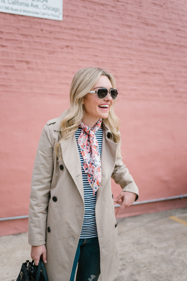 Blogger Bows & Sequins wearing a tan Old Navy trench coat, a floral scarf, and a striped shirt for spring.