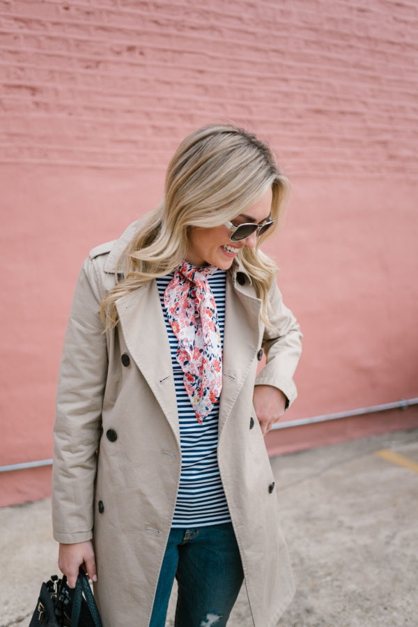 Fashion blogger Bows & Sequins wearing a trench coat, blue striped tee, and floral scarf, all from Old Navy.