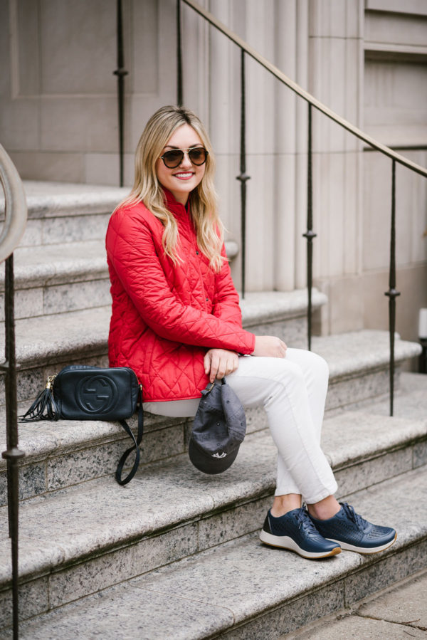 Bows & Sequins wearing a quilted red jacket by Barbour.