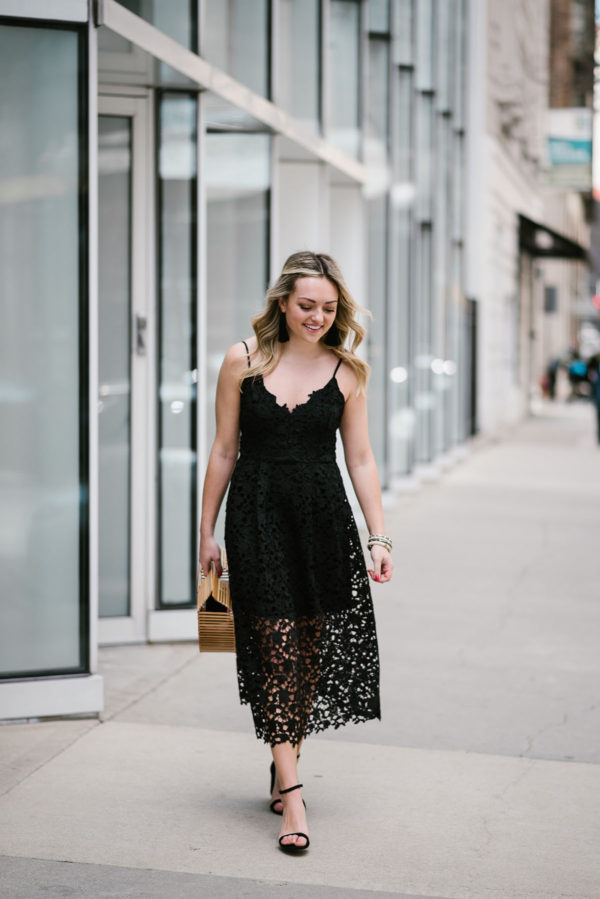 Bows & Sequins styling a black lace dress for wedding season.