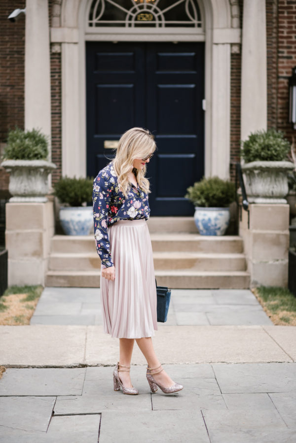 Fashion blogger Bows & Sequins wearing a Rebecca Taylor floral blouse and a pink Rachel Roy midi skirt in Chicago.