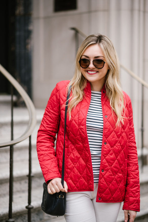 Bows & Sequins wearing Celine sunglasses, a striped shirt, and a red quilted jacket.