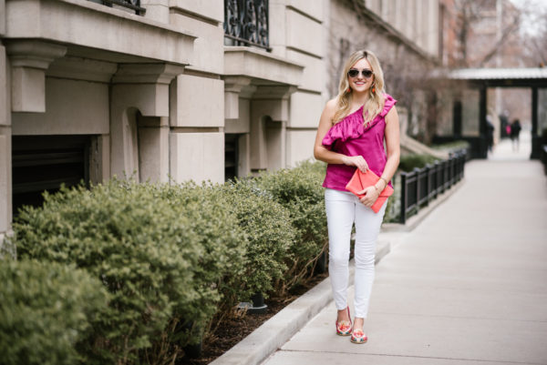 Jessica Sturdy holding a J.Crew clutch and wearing Old Navy white denim with leather loafers.