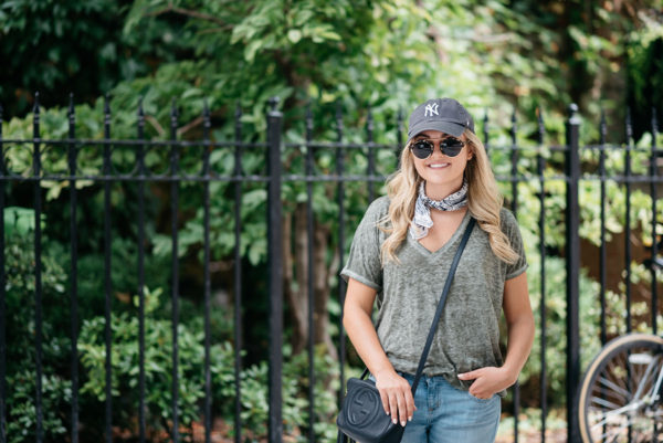 Fashion blogger Bows & Sequins wearing a v-neck tee with a patterned bandana and a Gucci crossbody bag.
