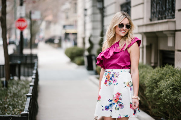 Jessica Sturdy wearing a ruffled fuchsia top with a Bows & Sequins floral skirt for spring.
