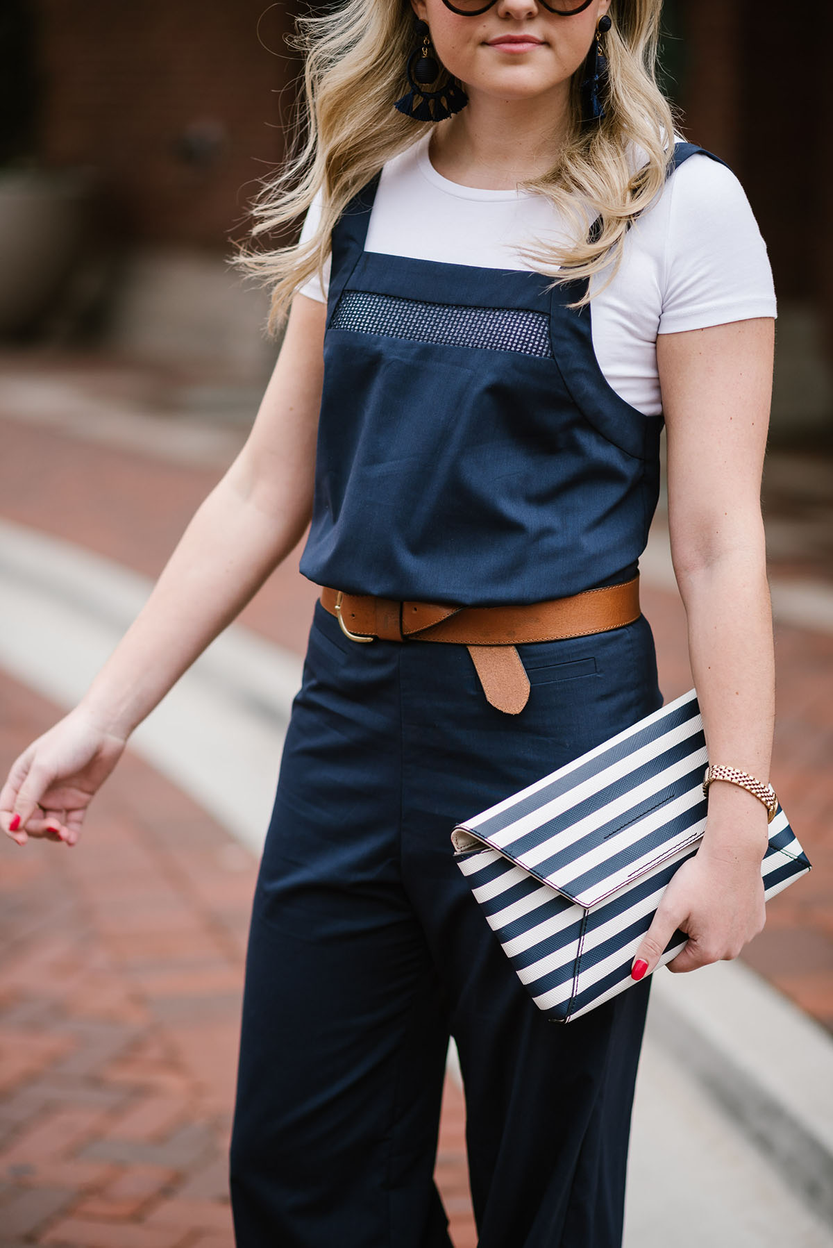 293a8342be83 Bows   Sequins styling a white tee shirt under a navy blue jumpsuit.  Jessica paired