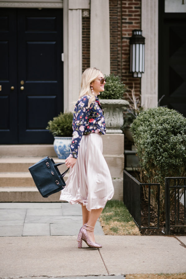 Lifestyle blogger Jessica Sturdy styling a Rebecca Taylor floral blouse, Rachel Roy midi skirt, navy blue Kate Spade bag, and glitter pumps in Chicago.