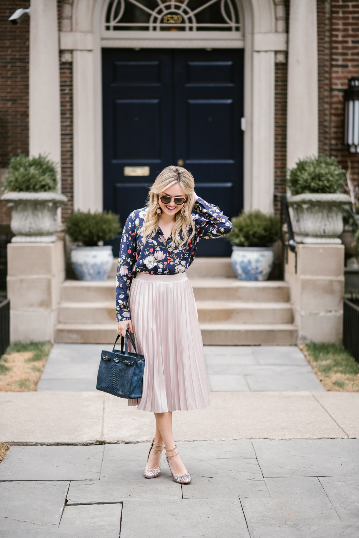 Jessica of Bows & Sequins wearing a navy floral Rebecca Taylor blouse, Rachel Roy pleated midi skirt, Kate Spade blush pink glitter pumps, and Celine tortoise aviator sunglasses.