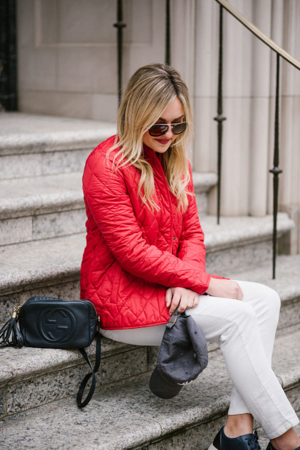 Bows & Sequins styling a red jacket with white jeans.