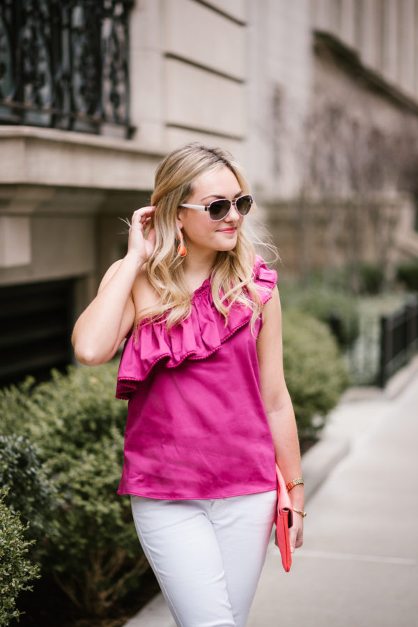 Bows & Sequins styling a fuchsia Devlin top with a coral clutch and Coach aviators for a casual outfit.