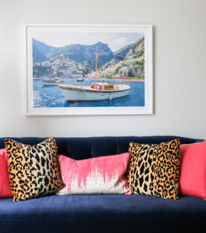 Bows & Sequins Chicago living room decor with Gray Malin print, custom Society Social navy blue velvet couch, and pink and leopard print pillows.