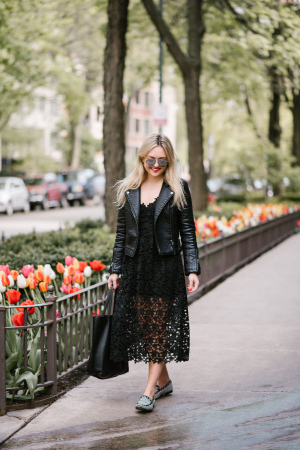 Fashion blogger Bows & Sequins wearing a black ASTR lace dress from Nordstrom, a black Topshop moto jacket, and Kate Spade loafers.
