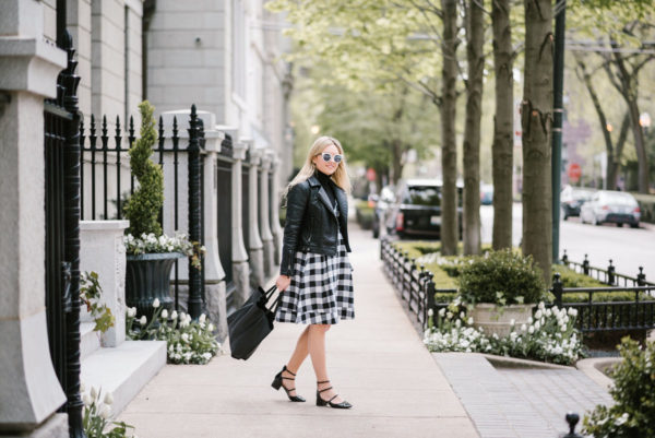 Chicago blogger Bows & Sequins wearing a Topshop moto jacket and a gingham midi dress from Modcloth with Zara patent strappy Mary Janes.