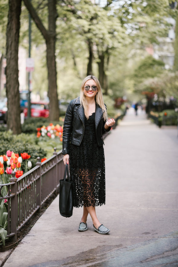 Bows & Sequins wearing a Topshop moto jacket, ASTR black lace dress, and Celine mirrored aviators.