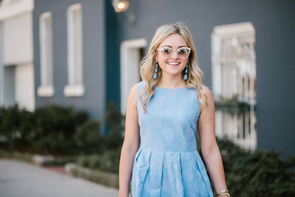 Bows & Sequins wearing a Sail to Sable polka dot dress with Nordstrom blush pink sunglasses.