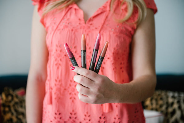 Beauty blogger Bows & Sequins sampling Burt's Bees Tinted Lip Oils.