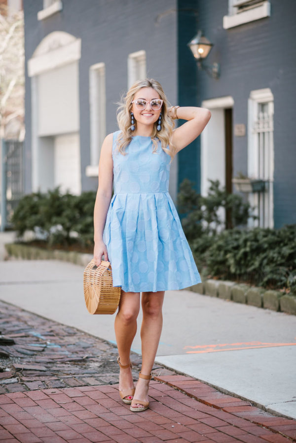 Chicago blogger Bows & Sequins wearing a Sail to Sable fit & flare dress with a Cult Gaia bamboo bag with Vince Camuto sandals and Tuckernuck statement earrings.