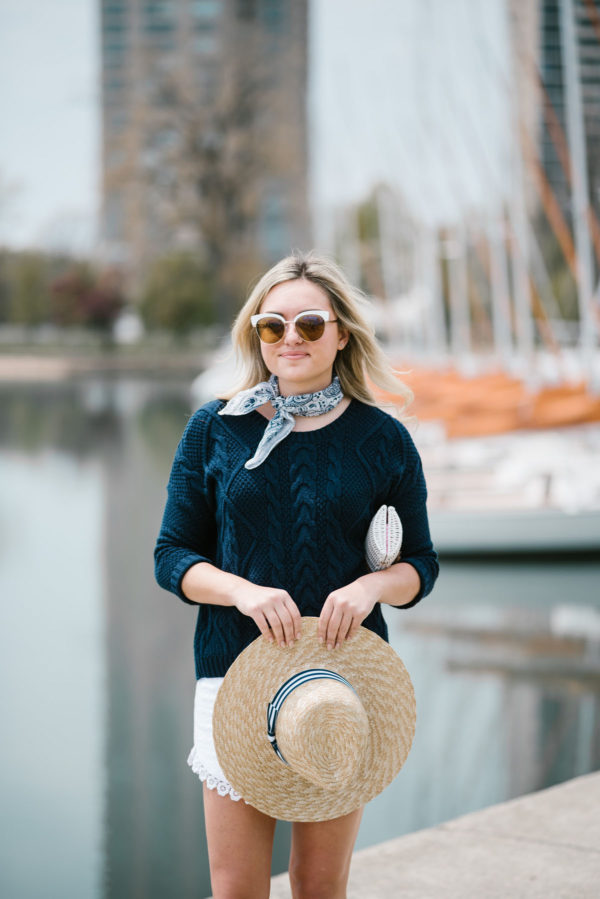 Chicago blogger Bows & Sequins wearing an Echo neckerchief and an Old Navy sweater with a straw hat and eyelet shorts.