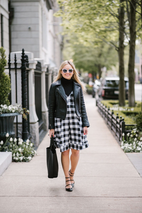 Lifestyle blogger Bows & Sequins wearing a Topshop moto jacket with a gingham midi dress, a leather tote, and Zara patent Mary Janes.