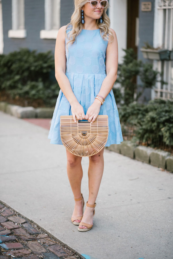 Fashion blogger Bows & Sequins wearing a Sail to Sable fit & flare dress with Vince Camuto leather wedges, a Cult Gaia bag, Tuckernuck statement earrings, and a Lele Sadoughi pearl cuff.