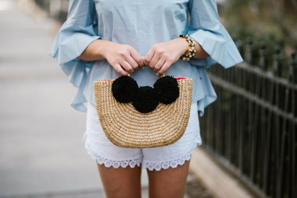 Chicago blogger Bows & Sequins holding a JadeTribe pom pom basket tote.