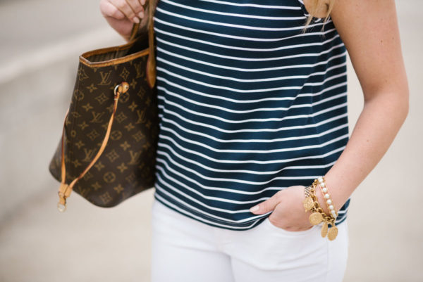 Chicago-based blogger Bows & Sequins wearing a Sail to Sable top with a Julie Vos coin bracelet and Lele Sadoughi pearl cuff and a Louis Vuitton Neverfull bag.