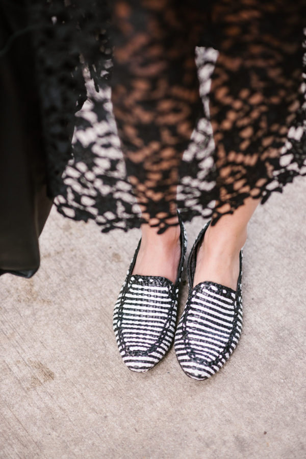 Bows & Sequins wearing black and white striped Kate Spade loafers.