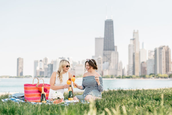 Bows & Sequins and Hallie Wilson of Among Other Things having a picnic along Lake Michigan in Chicago.