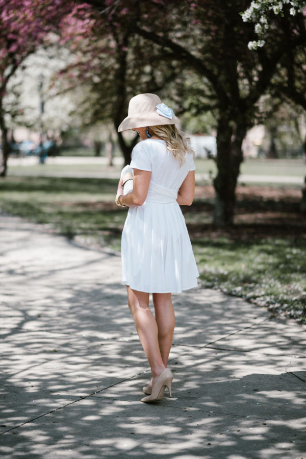 Bows & Sequins styling a little white dress with a straw hat and Kate Spade patent pumps.
