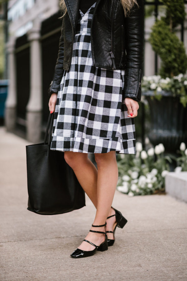 Chicago fashion blogger Bows & Sequins wearing a Topshop moto jacket, black gingham Modcloth dress, and Zara patent Mary Janes.