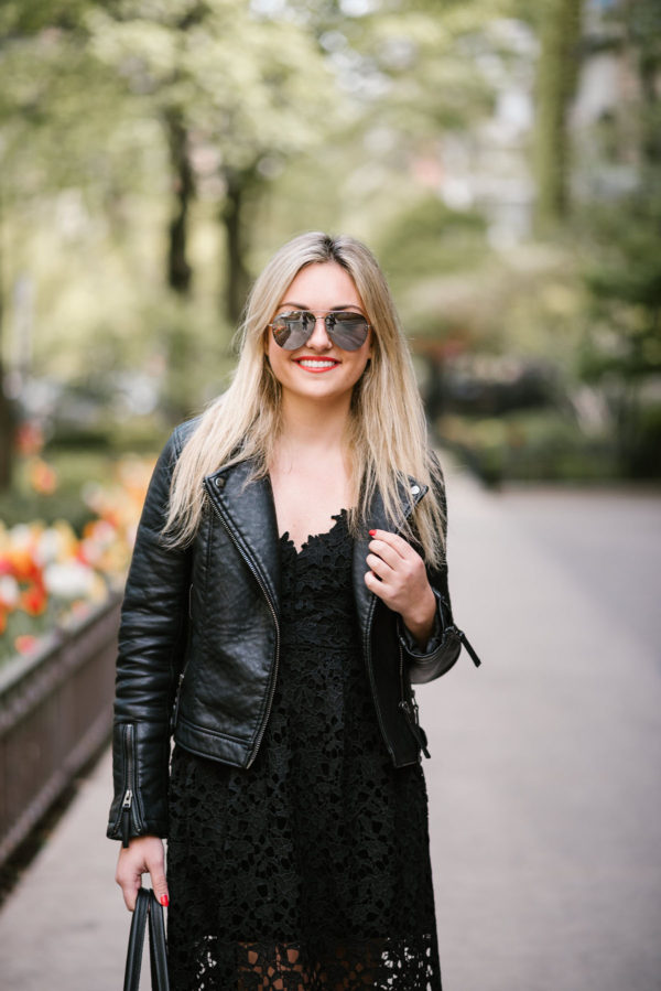 Jessica of Bows & Sequins wearing Celine mirrored aviator sunglasses and a black Topshop moto jacket.
