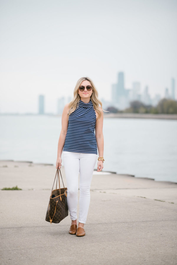 Chicago blogger Bows & Sequins wearing a striped halter tank, white denim jeans, and Dune London leather slides with Celine tortoise aviators.