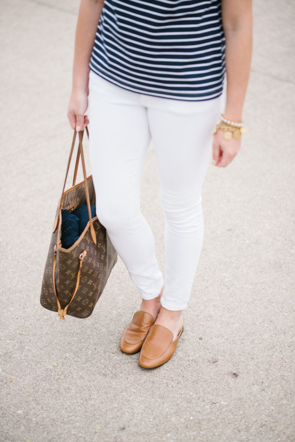 Fashion focused lifestyle blogger Bows & Sequins styling white Old Navy jeans with a Louis Vuitton Neverfull bag and brown Dune London slip-on loafers.