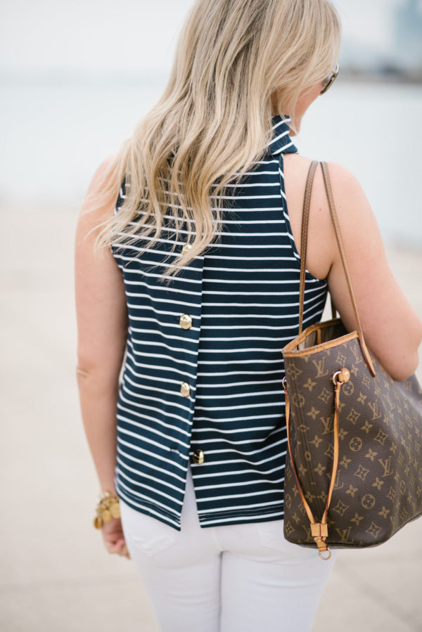 Chicago-based lifestyle blogger Jessica Sturdy wearing a Sail to Sable striped halter top with white jeans and a Louis Vuitton tote.