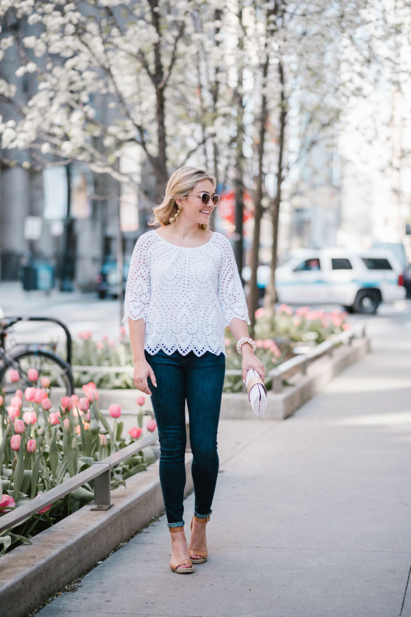 Chicago blogger Bows & Sequins wearing a white Vineyard Vines eyelet top with Call It Spring White Metal Rim sunglasses and Tuckernuck Kenneth Jay Lane Gold statement earrings.
