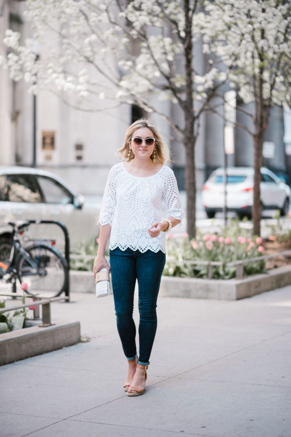 Fashion blogger Jessica Sturdy of Bows & Sequins wearing a white Vineyard Vine eyelet top with Old Navy jeans and Vince Camuto Leather Espadrilles in downtown Chicago.