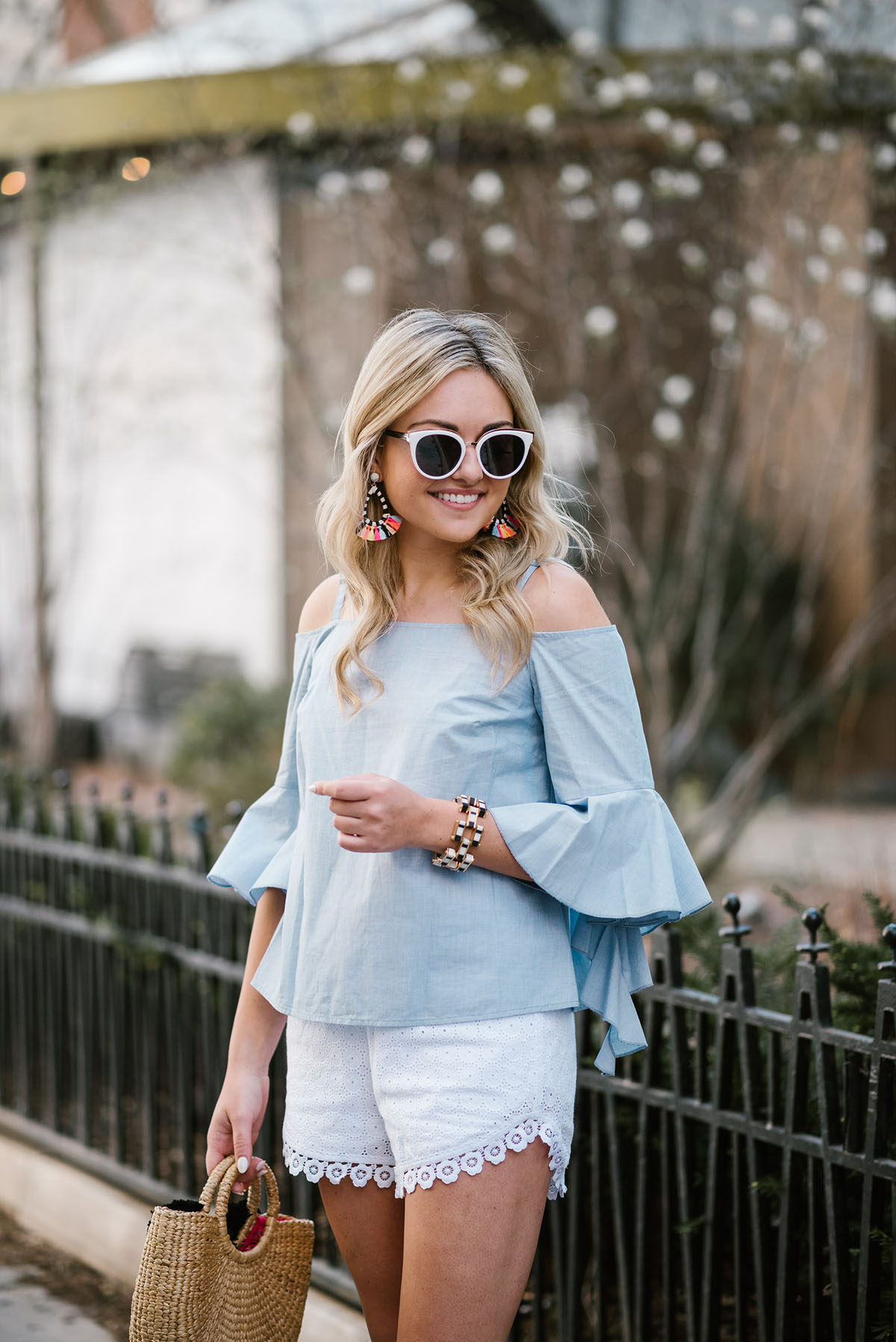 Chicago blogger Bows & Sequins wearing a bell sleeve chambray top and Kensie white eyelet shorts with Nordstrom sunglasses.
