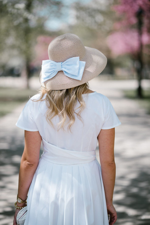 Bows & Sequins styling a Vineyard Vines bow hat with a little white dress in Chicago.
