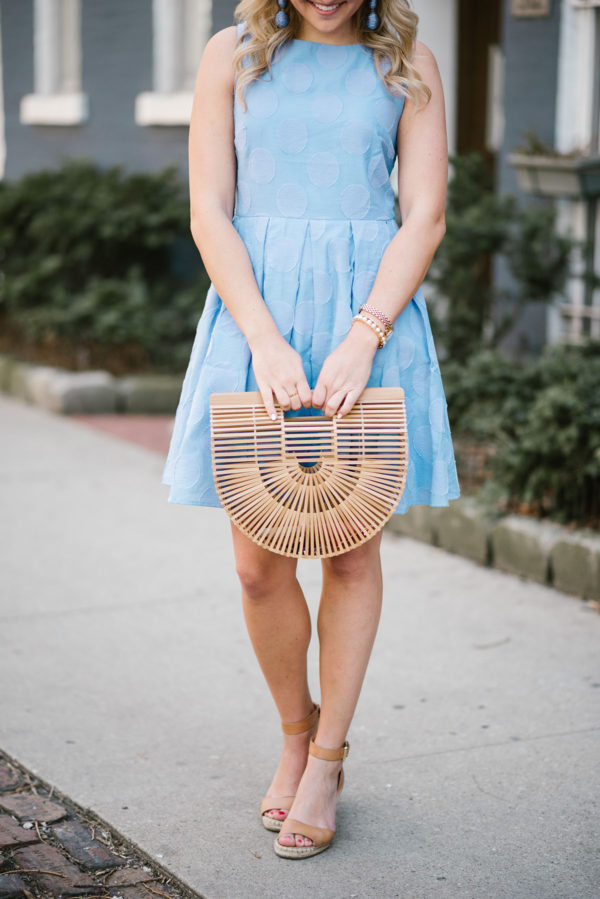 Chicago lifestyle blogger Bows & Sequins wearing a blue Sail to Sable dress with a Cult Gaia bamboo bag, a Lele Sadoughi pearl cuff, and Vince Camuto leather wedge sandals.