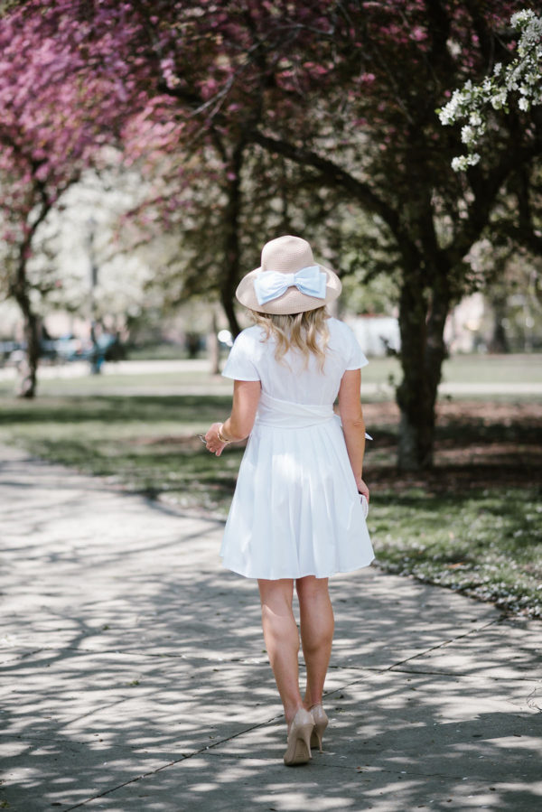 Bows & Sequins styling a little white dress with a straw hat with a bow and patent pumps during the spring in Chicago.