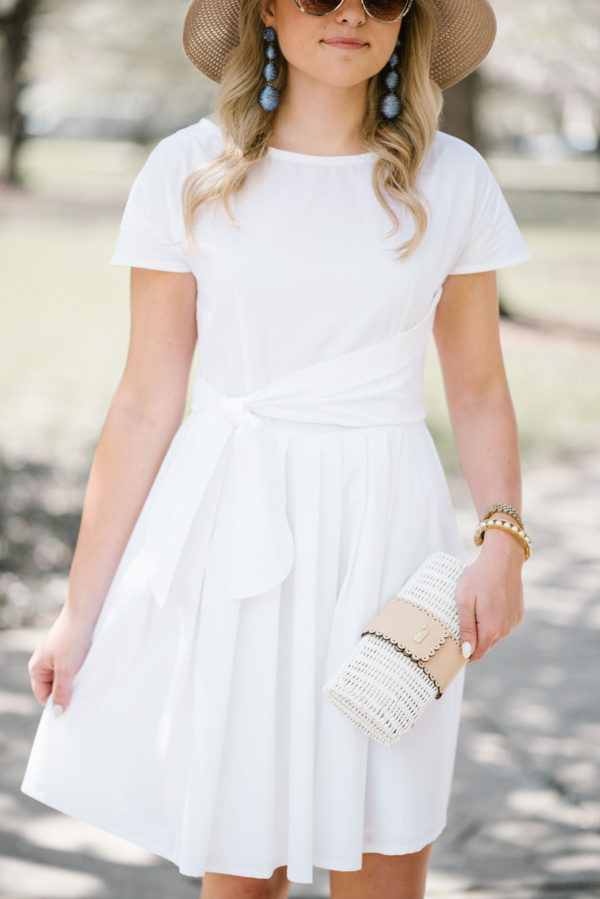 Bows & Sequins styling a white Vineyard Vines dress.