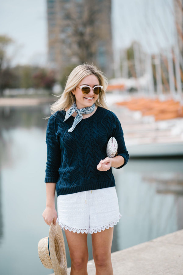 Bows & Sequins wearing an Old Navy sweater with a blue Echo bandana and white eyelet shorts with Nordstrom sunglasses.