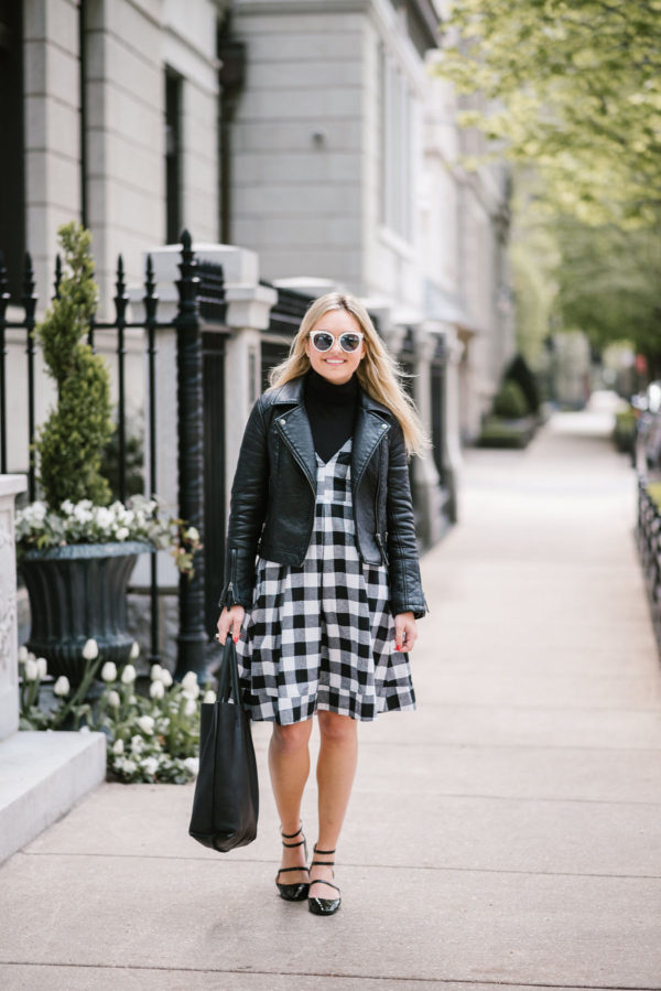 Chicago lifestyle blogger Jessica Sturdy styling a Modcloth black gingham midi dress with a Topshop moto jacket and J.Crew tissue turtleneck with a leather tote, Nordstrom sunglasses, and Zara Mary Janes.