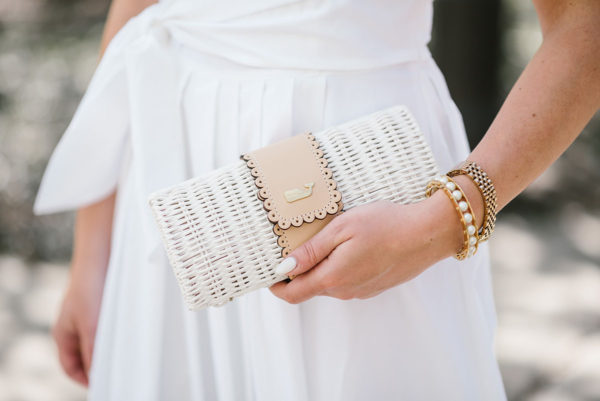 Bows & Sequins styling a white wicker rattan clutch from Vineyard Vines.