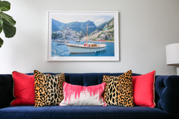 Bows & Sequins living room decor with a Gray Malin print, Society Social navy velvet couch with pink and leopard throw pillows.