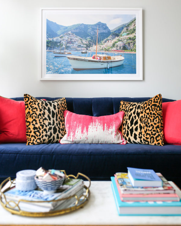 Bows & Sequins living room decor with a Gray Malin print, Society Social navy velvet couch, coffee table and tray.
