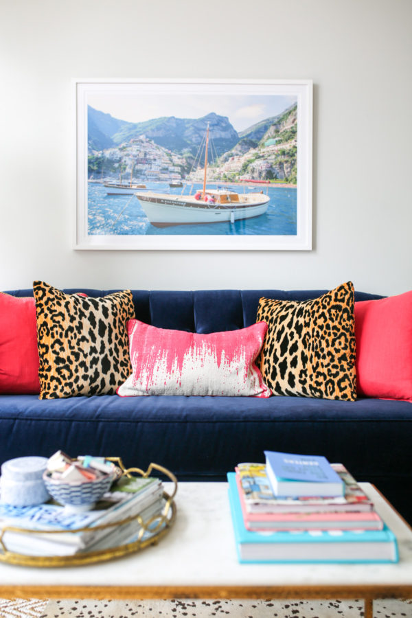 Bows & Sequins Chicago living room: velvet navy couch, Gray Malin print, marble coffee table, pink and leopard throw pillows.