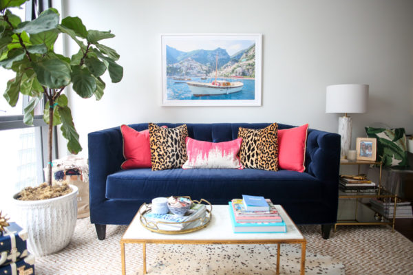 Bows & Sequins Chicago living room decor with a fiddle leaf fig, Gray Malin print, marble coffee table with a gold mirror tray