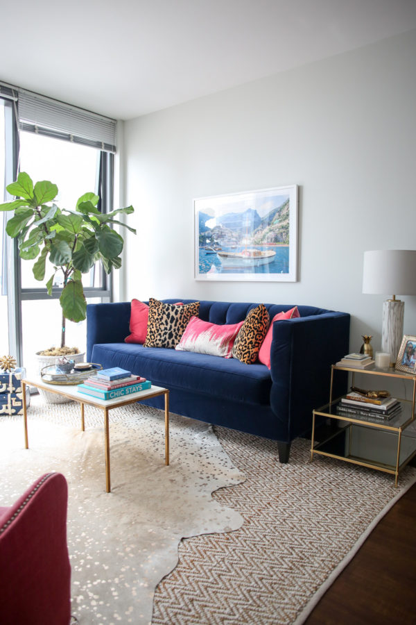 Bows & Sequins Chicago living room decor with a fiddle leaf fig, Gray Malin print, marble coffee table, gold side table