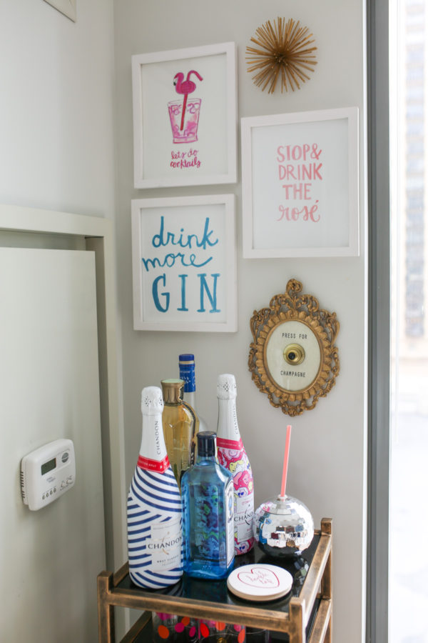 Bows & Sequins bar cart with Stop & Drink the Rose and Drink More Gin wall prints.